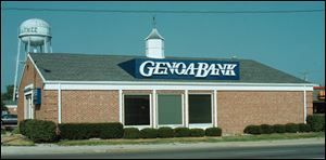 Genoa Banking Co. plans to open a branch in a former Sylvania Township firehouse now that the bank and ABC Warehouse have received a waiver on parking requirements.