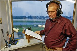 Hall of Fame announcer Sam McKee memorizes horses' names and numbers before calling Race 5, his first at Raceway Park since 1988. Mr. McKee now calls races at The Meadowlands.