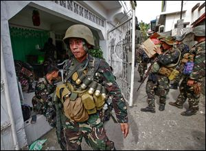 Soldiers arrive in Zamboanga in the south Philippines on Sunday with supplies for the offensive against Muslim insurgents. The fighting began a week ago.
