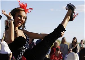 Miss Alabama Chandler Champion shows her shoe during the Miss America Shoe Parade at the Atlantic City boardwalk.