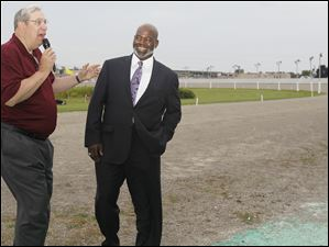 U.S. Trotting Association's John Pawlak, left, speaks with Toledo mayor Mike Bell after the first race.