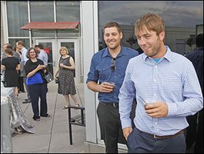 Bryan McDougle, of Oregon, left, and Brad Anderson, of Toledo, check out a social media photo app at the Toledo Lucas County Public Library's Rockin' on the Rooftop event.