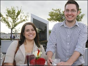 Heather Schramm, left, and Andrew Grady, both of Toledo, at the Toledo Lucas County Public Library's Rockin' on the Rooftop downtown.