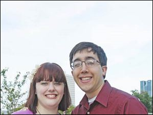 Katherine Hodder, left, and Adam Assink, of Toledo, at the Toledo Lucas County Public Library's Rockin' on the Rooftop event.