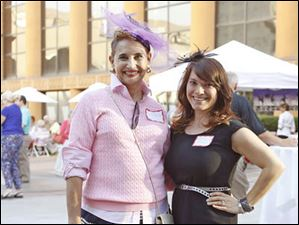 Event Chairman Laura Draheim, left, and Kristin Rummell, right, stand together during the plaza party at the Valentine Theatre in Toledo.