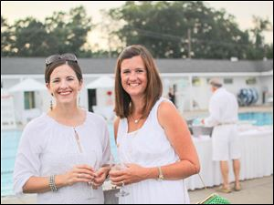 Sabrina Weaver and Blair Nooney poolside at the White Party.