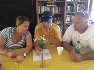 Coach Tracy Mauntler and Coach Al Werner and John Cameron at the table putting the line ups together.