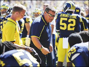 Brady Hoke, talking to his team on Saturday, put the Wolverines through a practice on Sunday after a lackluster effort in their win over Akron.