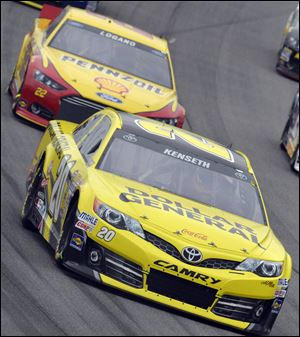 Matt Kenseth drives past Joey Logano during Sunday night's NASCAR Sprint Cup series race at Chicagoland Speedway in Joliet, Ill. Kenseth won.