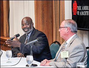 Mayoral candidates Mayor Mike Bell and D. Michael Collins debate during the annual Architects Institute of America dinner at the Toledo Club.