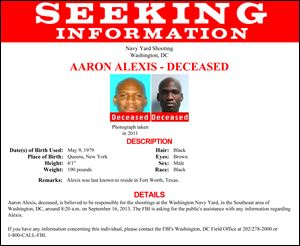 This image released by the FBI shows the poster seeking more information on Aaron Alexis, who police believe was a gunman at the Washington Navy Yard shooting in Washington, this morning.