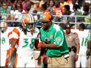 Florida A&M's Earl Holmes spent six seasons with the Steelers, one with the Browns, and three with the Lions. Now Holmes, 40, is 1-2 in his first season as the Rattlers' head coach.
