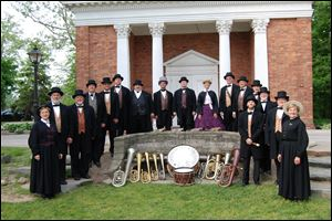 Members of the Dodworth Saxhorn Band perform on historic brass, woodwind, and percussion instruments from the 1840s to 1880s. They will appear in concert Sunday at Historic Woodlawn Cemetery.