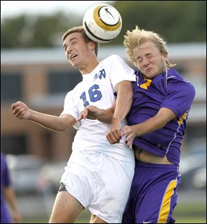 Anthony Wayne's AJ Witte, left, and Maumee's KJ Mitchell fight to head the ball.