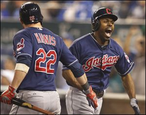 Cleveland Indians' Michael Bourn, right, is congratulated by Jason Kipnis (22) on his solo home run off Kansas City Royals relief pitcher Luke Hochevar during the ninth inning.