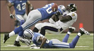 Earl Holmes forces a fumble during a game against the Baltimore Ravens on Oct. 9, 2005. Holmes was a fourth-round pick of the Pittsburgh Steelers in 1996 who also played one season with the Browns.