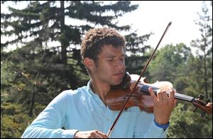 Malik Khalfani, a Maumee junior, was awarded concert master last year with the Toledo Symphony Youth Orchestra. He placed eighth at a state violin competition to earn a spot with the Ohio all-state orchestra. He made his conducting debut when he was 14.