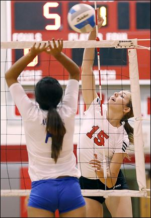 Bedford's Kayla Gwozdz (15) hits the ball against  Adrian's Bianca Negron (7) during Tuesday's match. Gwozdz finished with a team-high 11 kills.