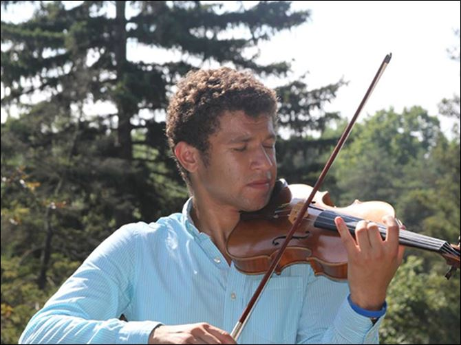 19S5Violin Malik Khalfani, a Maumee junior, was awarded concert master last year with the Toledo Symphony Youth Orchestra. He placed eighth at a state violin competition to earn a spot with the Ohio all-state orchestra. He made his conducting debut when he was 14.