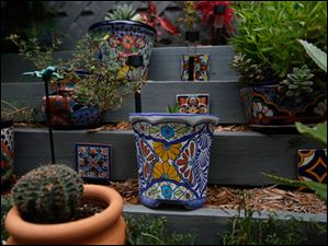 Bills's patio includes Mexican tiles and growing containers, called Talavera Pots, stacked on tiers