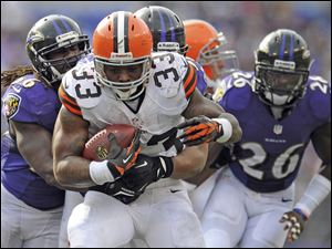 Cleveland Browns running back Trent Richardson carries the ball during an NFL football game against the Baltimore Ravens in Baltimore. The Browns have traded Richardson to the Indianapolis Colts in a surprise move less than two years after drafting him in the first round. ]