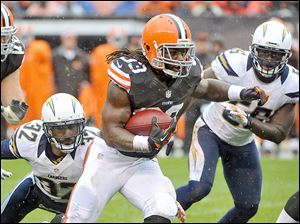 Cleveland Browns running back Trent Richardson (33) breaks a tackle by San Diego Chargers safety Eric Weddle (32) on a 26-yard touchdown run in the first quarter of an NFL football game last year.