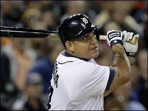 Detroit Tigers' Miguel Cabrera hits a solo home run against the Seattle Mariners in the sixth inning.