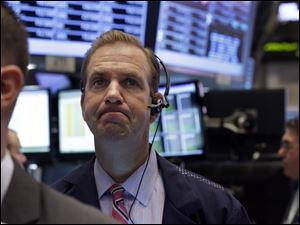 Stock markets close higher after Federal Reserve announces it will continue economic stimulus.