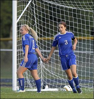 Anthony Wayne's Jessie Mattimoe, left, congratulates Abby Allen after Allen scored the first goal against Maumee. The Generals are 6-3-1, 3-0-1 in the NLL.