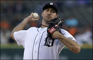Detroit Tigers starting pitcher Justin Verlander throws against the Seattle Mariners in the first inning.