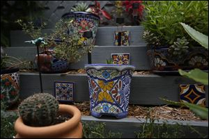 His patio includes Mexican tiles and growing containers, called Talavera Pots, stacked on tiers.