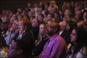 Karyn Benner, center, and William White, both of Toledo, center right, listen as Salman Khan talks about Khan Academy.