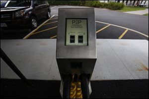The Toledo Art Museum has installed charging stations for electric vehicles in the parking lot behind the museum. Though not yet fully operational, the installation has been completed.  THE BLADE/KATIE RAUSCH