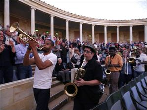Trombone Shorty leads his band and students from the Toledo School for the Arts around the Peristyle,