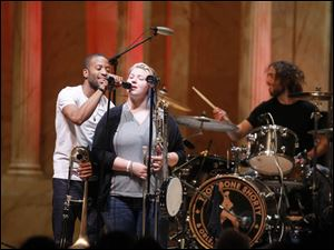Toledo School for the Arts student Kendal Smith sings with Trombone Shorty.