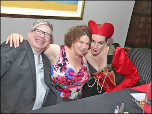 Unknow man, Sandra Sauder, event chairman, and the Queen of Hearts aka Jenny Creswell an opera singer.