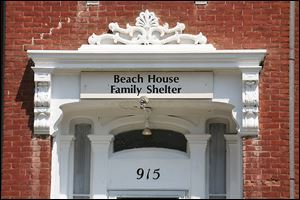 Beach House operates in a mansion built in 1867 on North Erie Street near downtown Toledo. The shelter has six bedrooms on the second floor and one bedroom for disabled residents on the first floor. It has three bathrooms for its residents. The shelter was started in 1921 to serve homeless women and children.