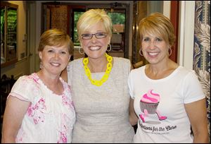 Kelli Andres, co-host, Chrys Peterson, news anchor at WTOL News 11, and Liz Allen, co-host, at the third annual Confections for the Cure event.