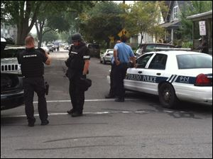 Toledo police prepare during the standoff.