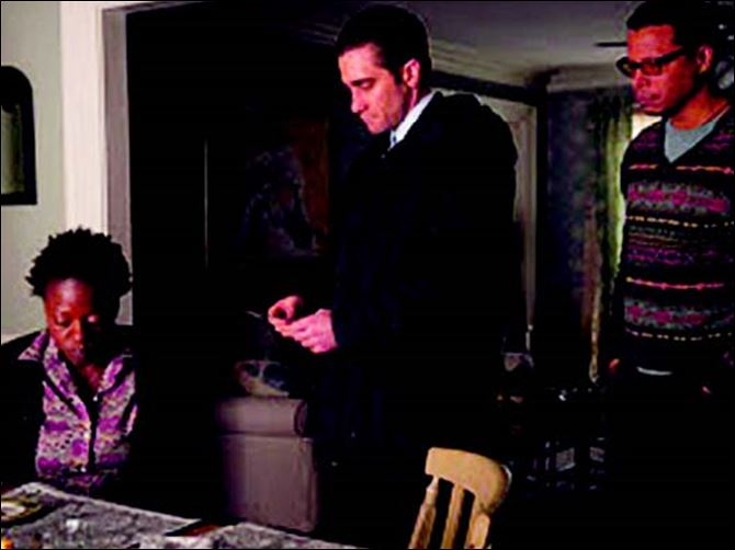 PRIS3.jpg Gyllenhaal in a scene with Viola Davis and Terrence Howard in 'Prisoners.'