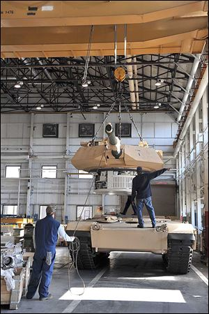 A turret is placed on a tank at the Lima plant, which has had funding issues in recent years.