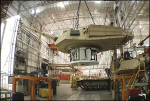 The contract from Saudi Arabia to refurbish 84 U.S.-built Abrams tanks, like those above, is one of four or five international contracts the plant is working to obtain, an General Dynamics spokesman said.