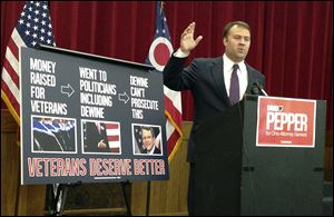 Democrat David Pepper speaks to reporters at a news conference Friday  in Columbus. Mr. Pepper wants Mike DeWine to recuse himself from the case against a Florida man accused of running a scam charity.