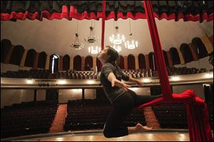 Instructor Erin Garber-Pearson of Toledo shows a flying technique during a beginner aerial silks class at the Birds Eye View Circus Space at the Collingwood Arts Center.