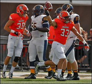 Bowling Green's Paul Swan celebrates after recovering a Murray State fumble in the first quarter.