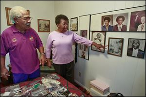 Norman and Ora Bell, Mayor Mike Bell's parents, talk about their family history while looking at photos at their home on Stickney Avenue. The Bells moved to Toledo from Louisiana.