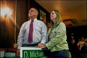 Sandy Drabik, watching election returns with her husband D. Michael Collins during the 2009 Toledo primary, also has attempted research into her husband's family lore but said Ireland's turbulent history has resulted in records gaps.