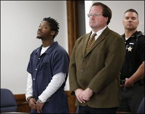 Daquaine Booth, left, in court.