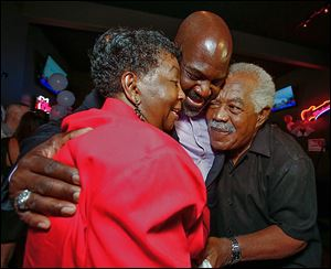 Mayor Mike Bell celebrates winning Toledo's primary election with his parents, Ora and Norman Bell, Sr. The mayor said family is a driving force for him.
