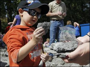 Sylvania resident Kaiden Levine, 5, bags a fossil he found.